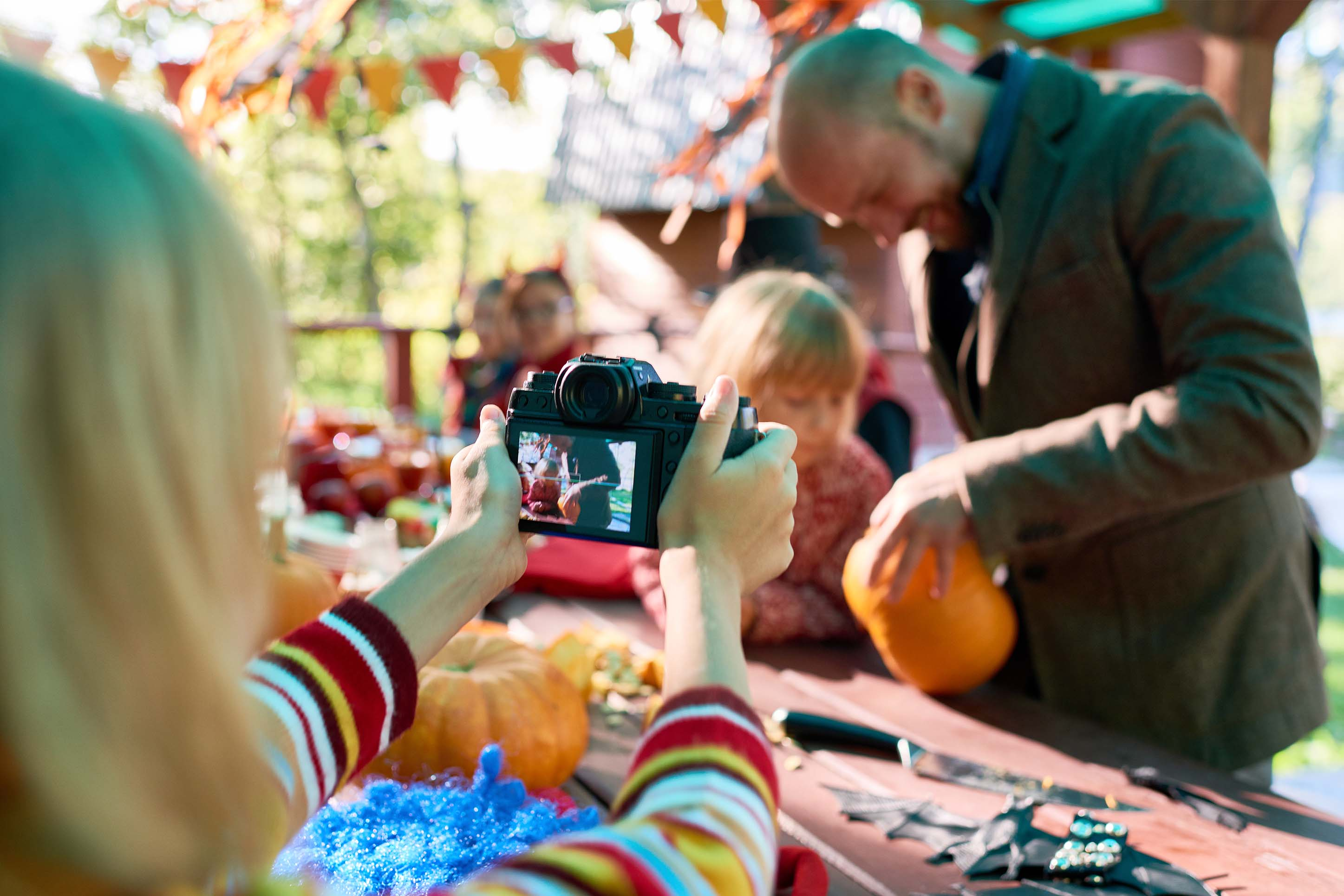 child decorating a pumpkin