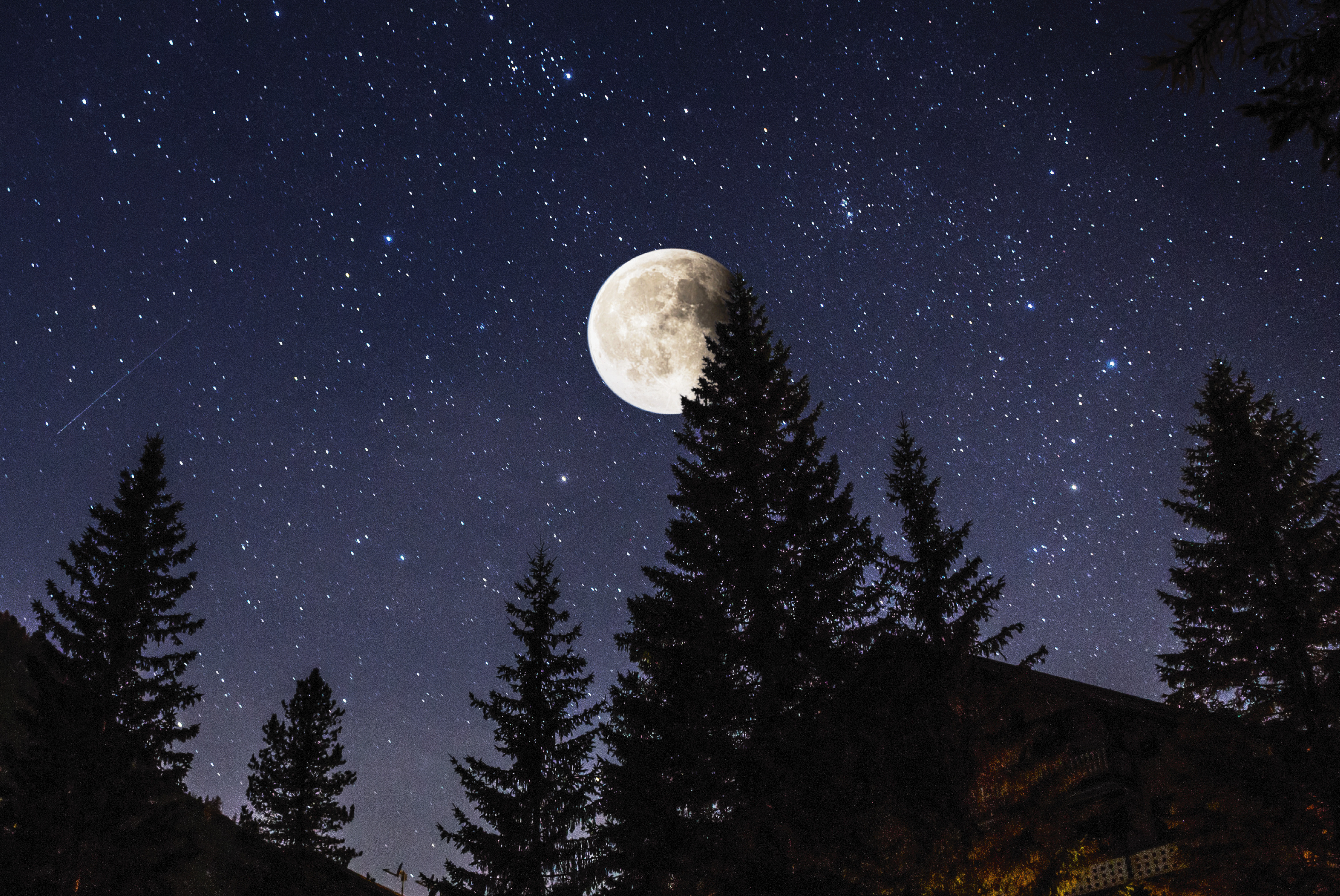 the moon and a clear, starry sky
