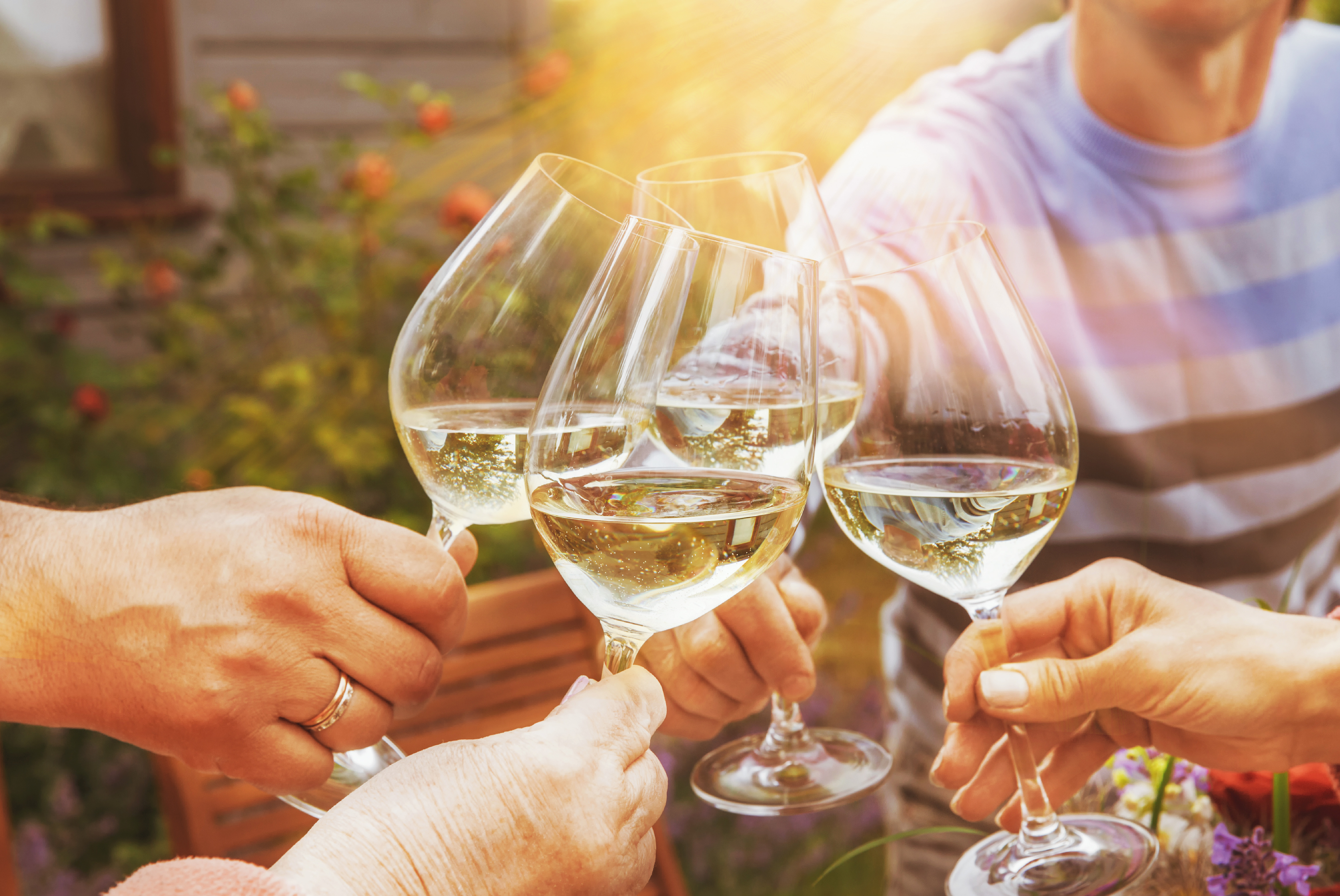 a group of people drinking white wine