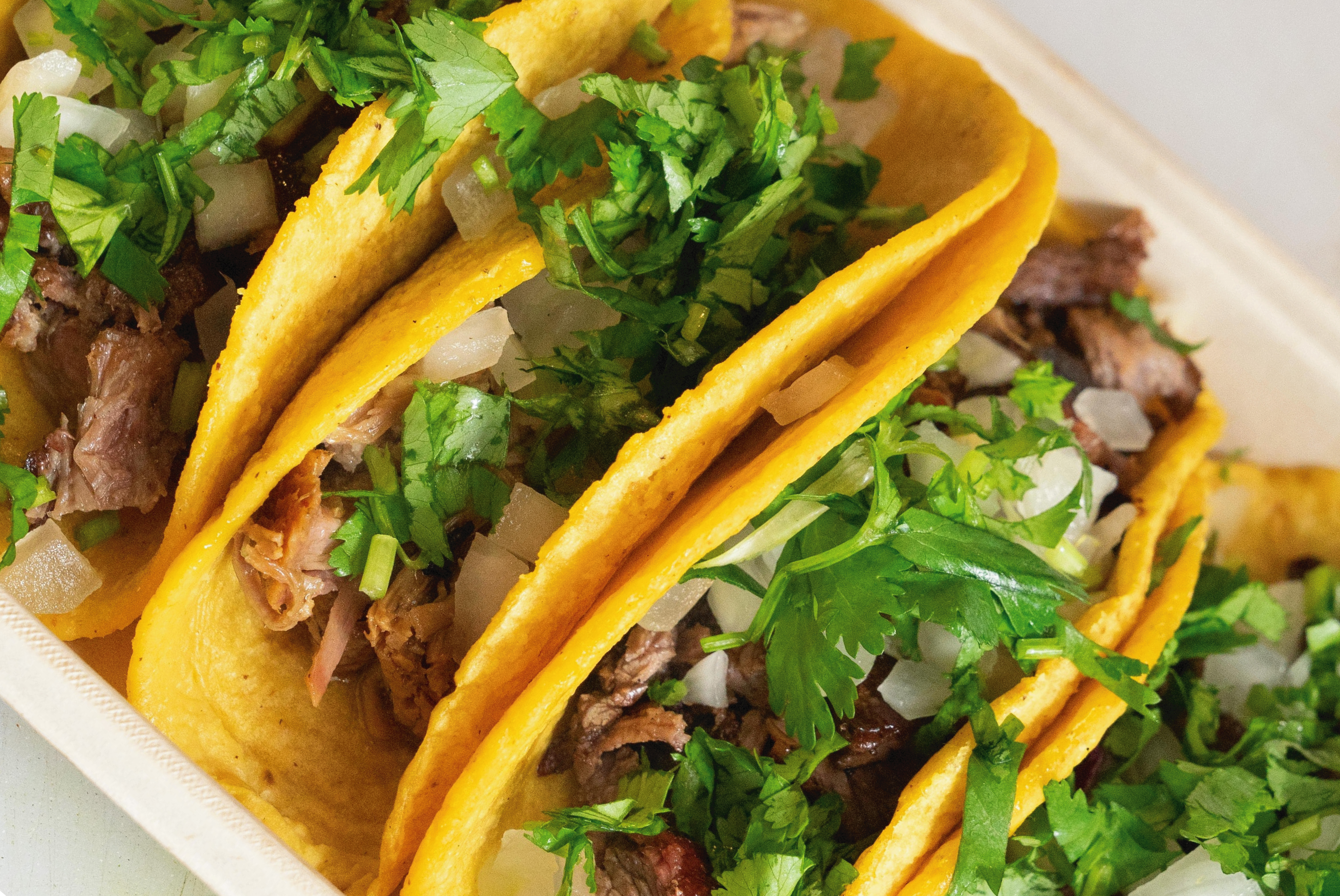 tacos with meat and cilantro