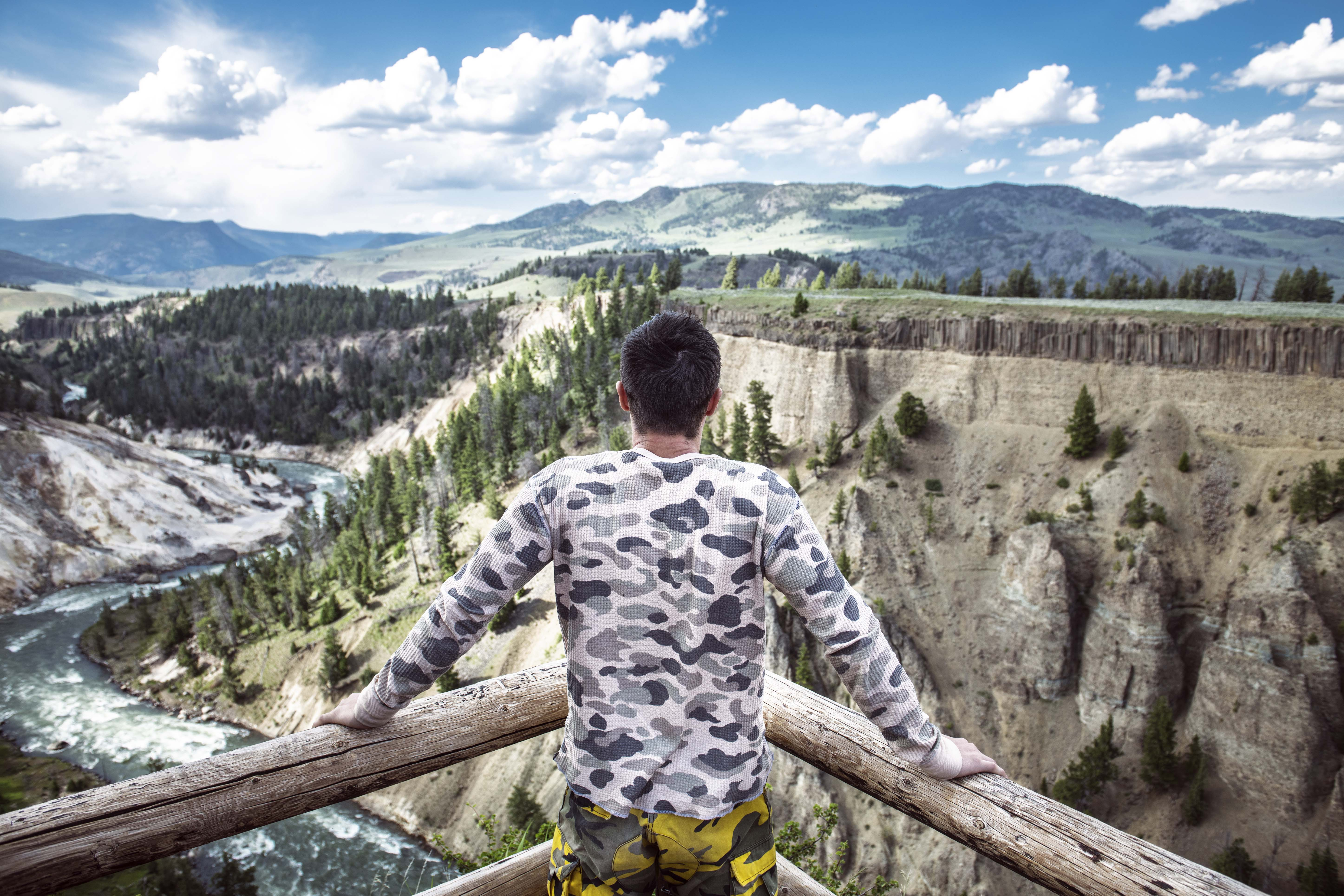 man viewing yellowstone river from overlook