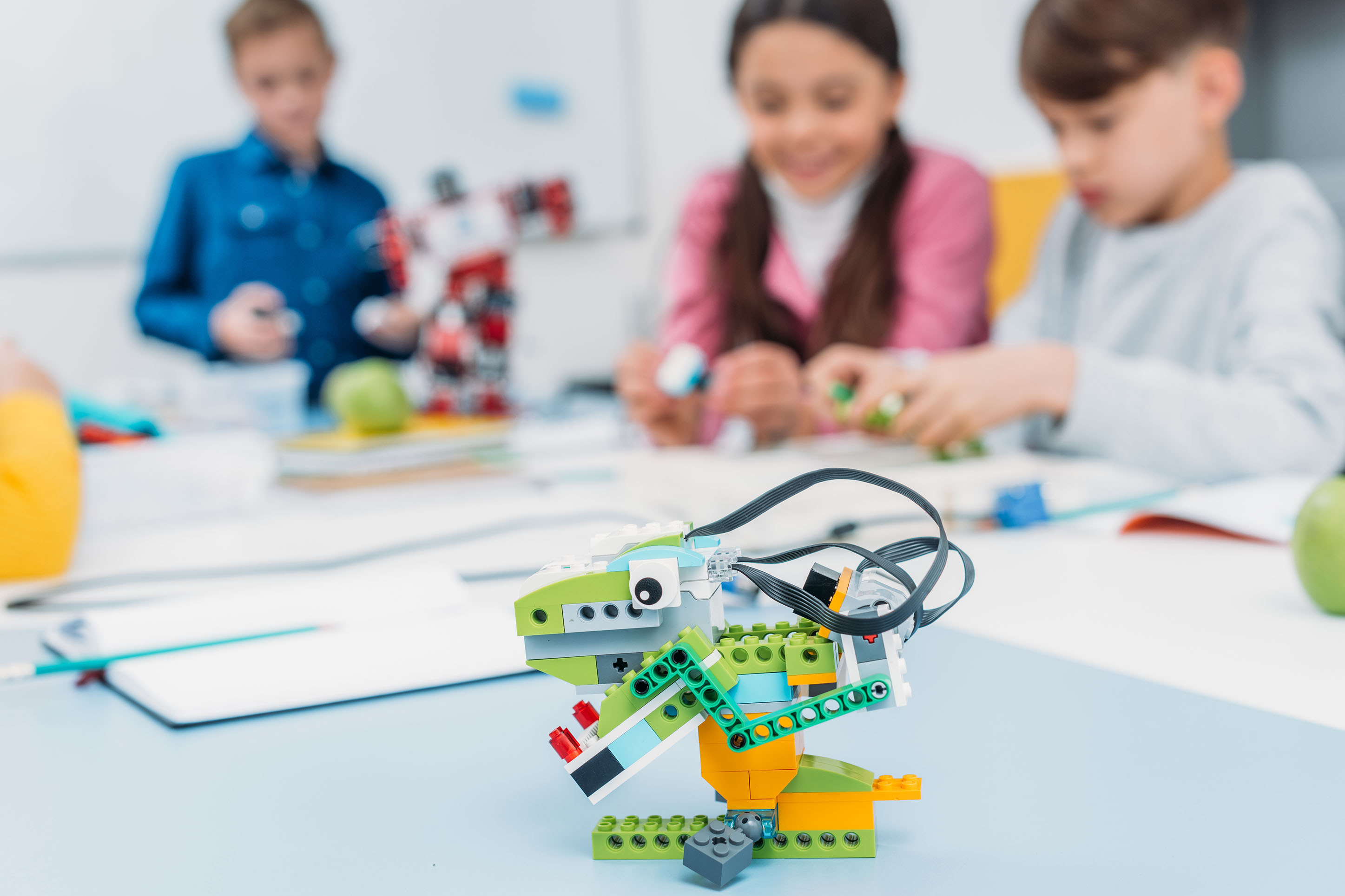 children playing with Lego robots at the Montana Science Center