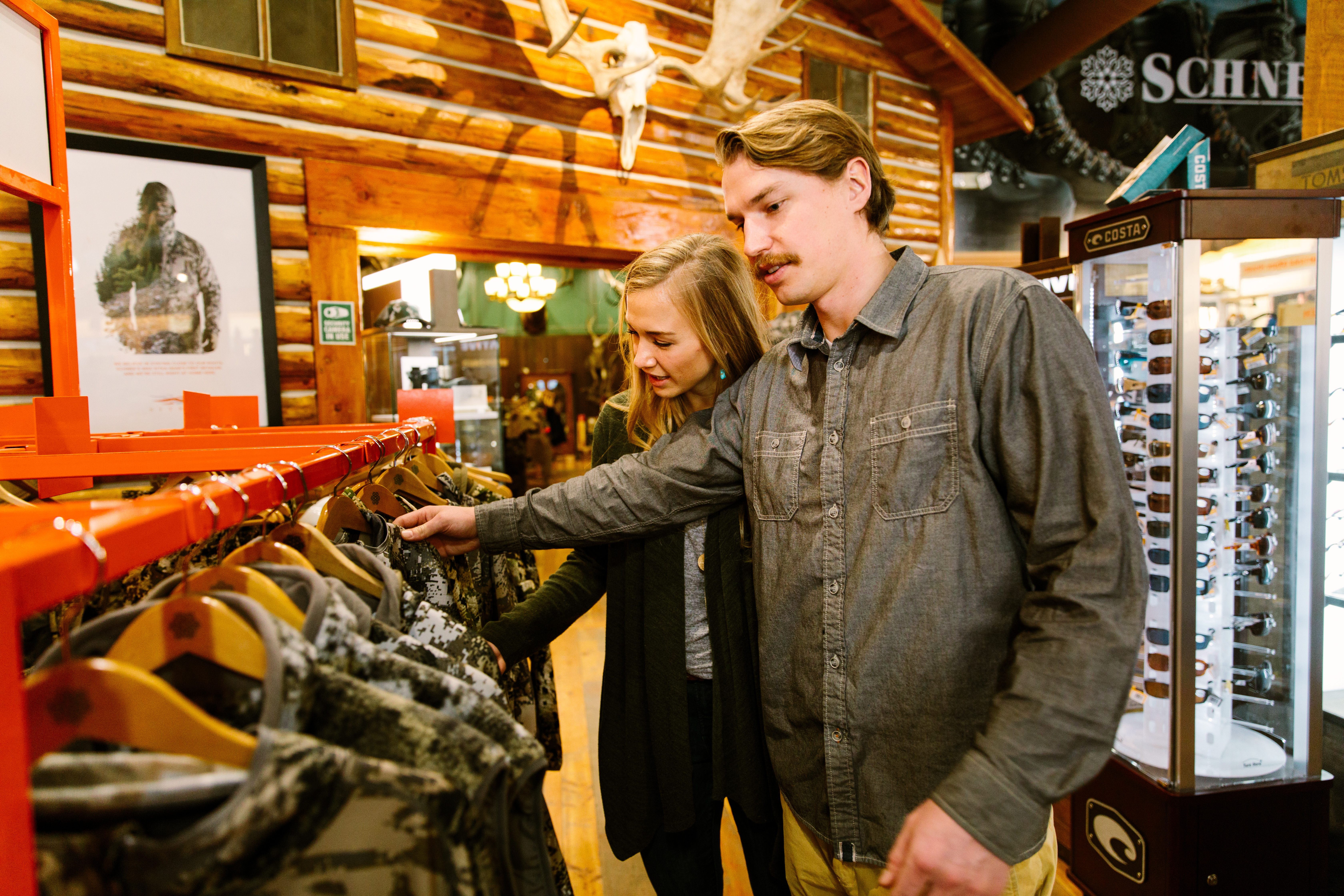a couple shopping at Schnee's boots in Bozeman