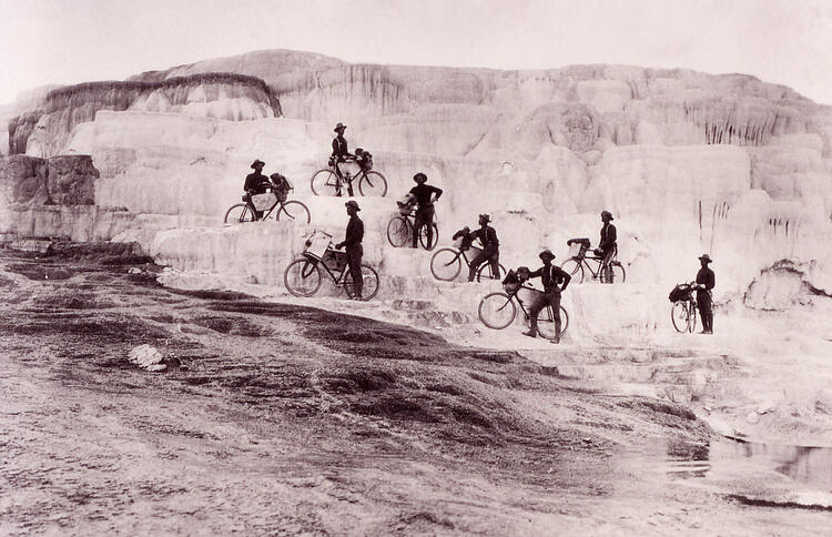 Army bicyclists on Mammoth Hot Springs Terraces; Photographer unknown; Around 1896