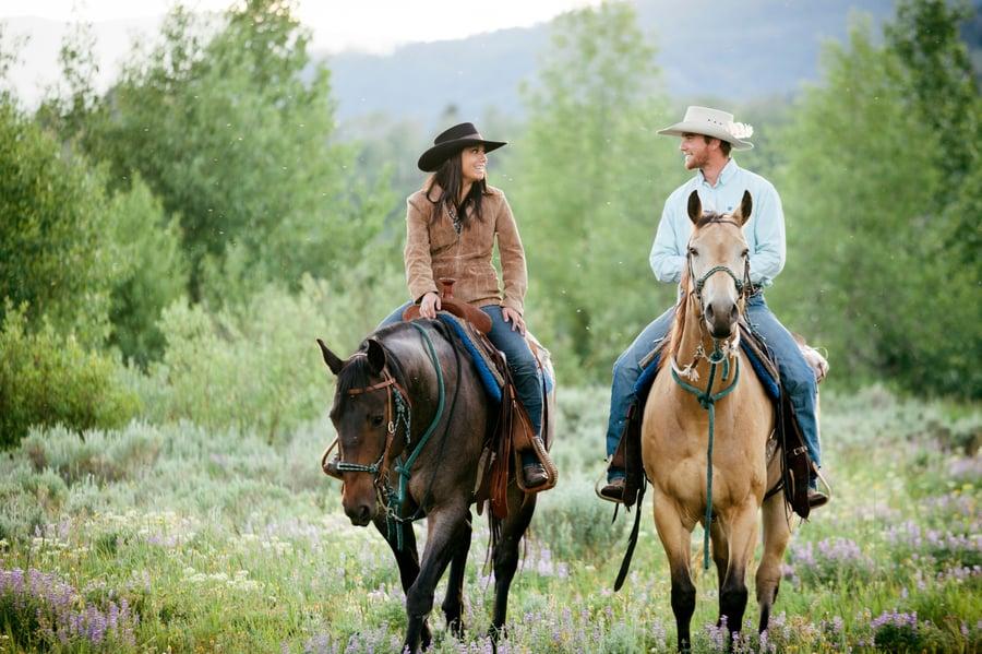 couple horseback riding in bozeman montana