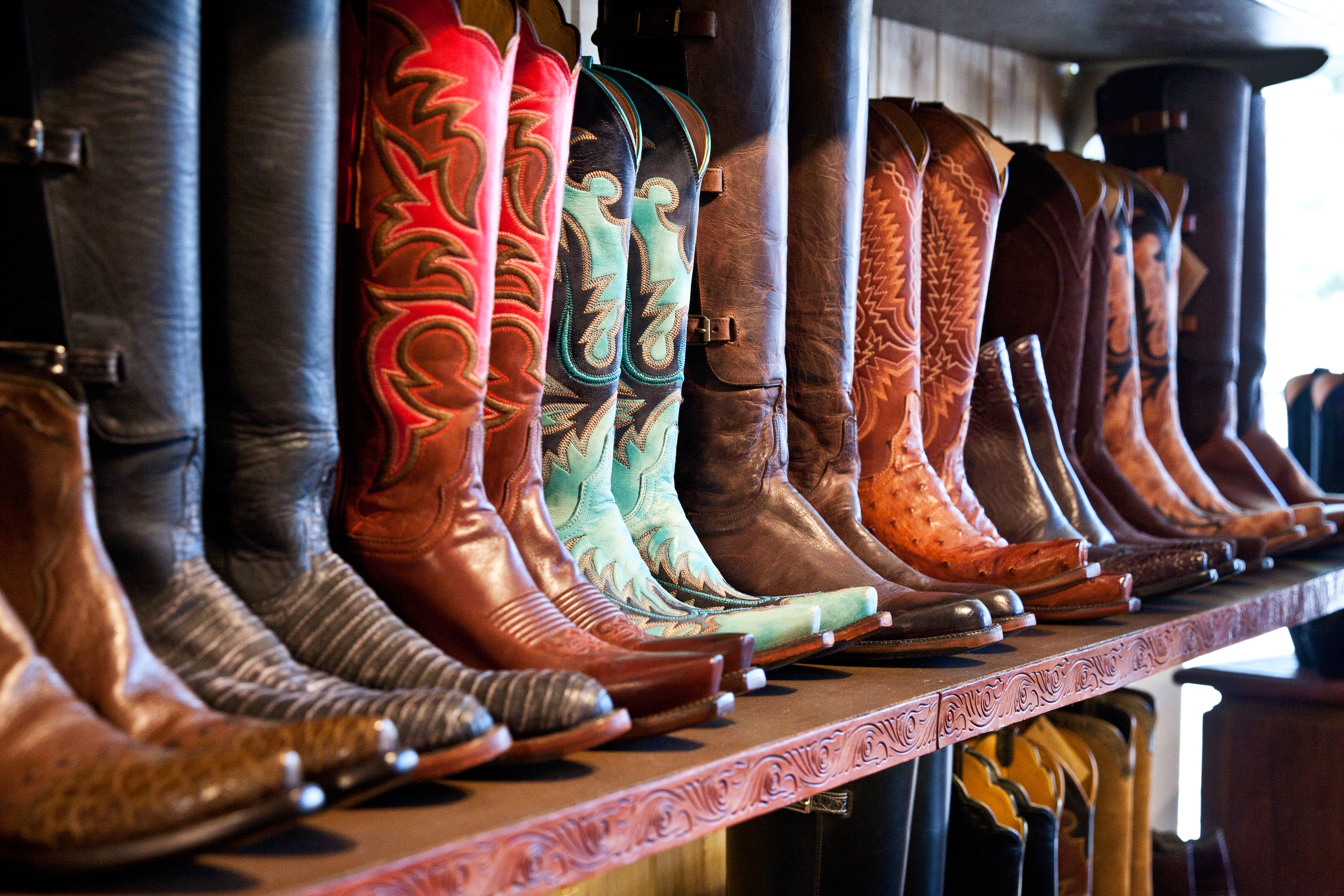western-style boots lined up on a shelf