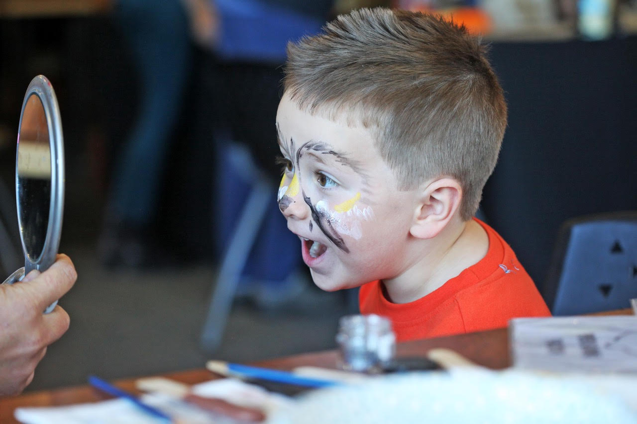 boy views his owl face painting