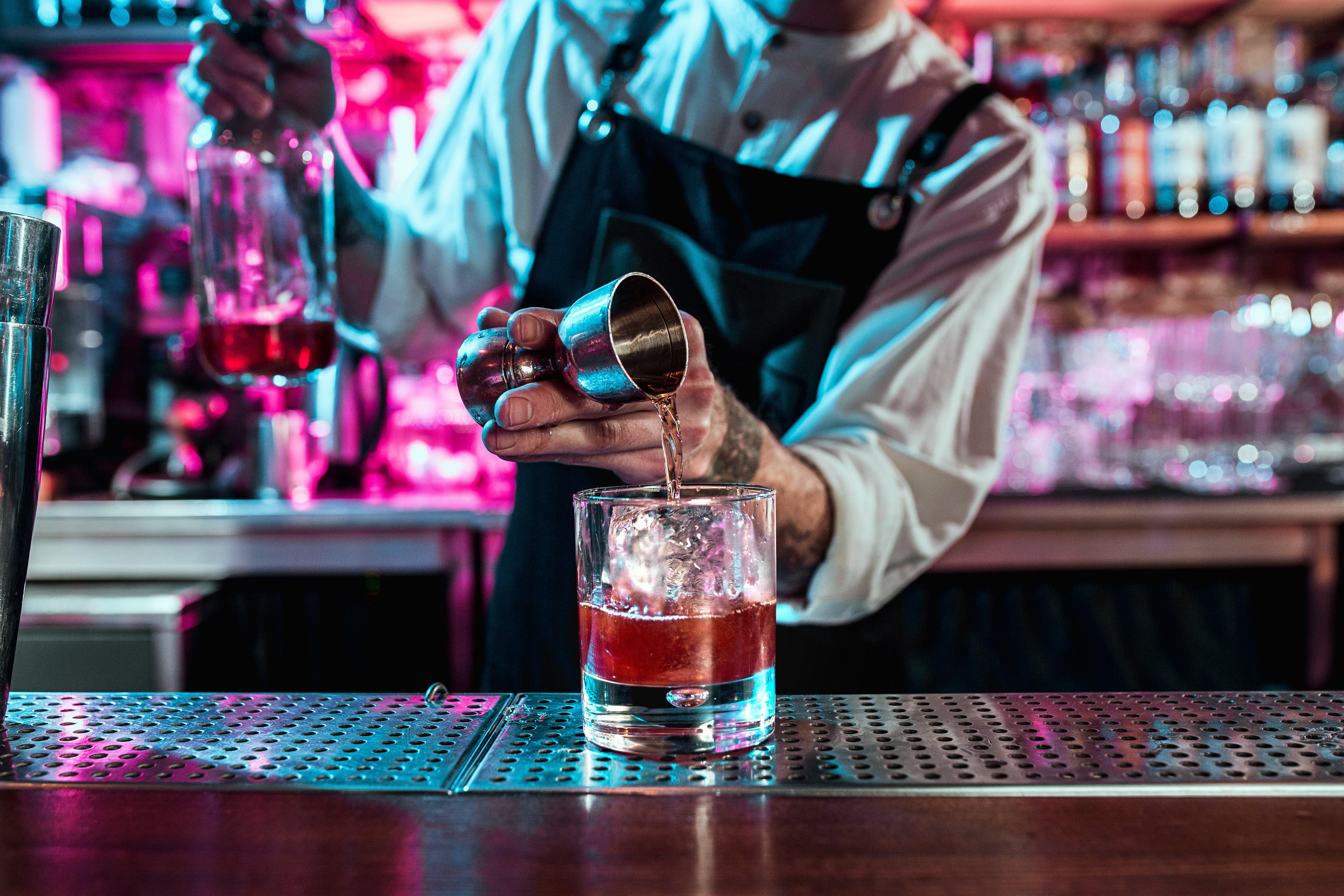 man mixing a cocktail at a bar